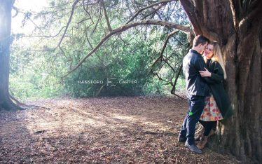 An image of the happy couple in their secret place in the woods - wedding photography by Sam of Hansford Carter, a Kent wedding photographer