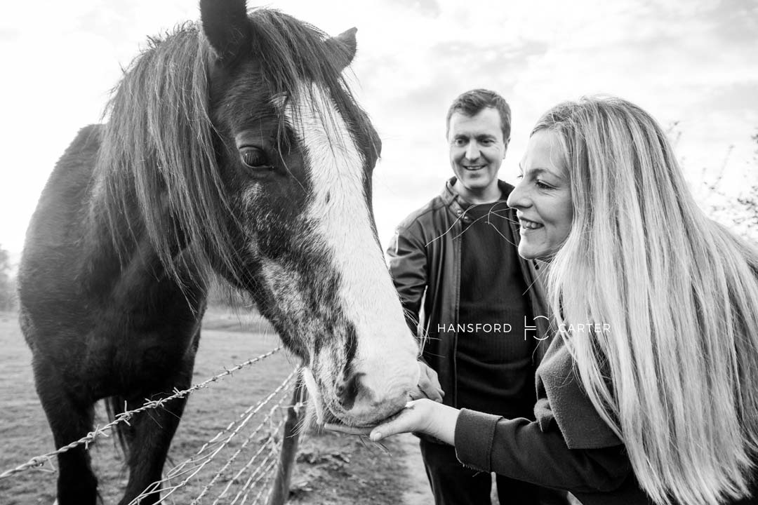 An image of Kirsty and Wayne with a horse - wedding photography by Sam of Hansford Carter, a Kent wedding photographer