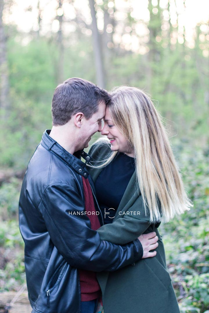 An image of the happy couple in the woods - wedding photography by Sam of Hansford Carter, a Kent wedding photographer