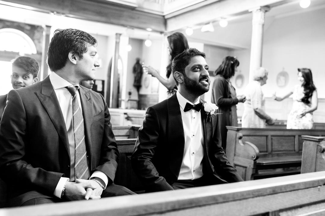 An image of the groom excited to see his bride - wedding photography by Sam of Hansford Carter, a Kent wedding photographer