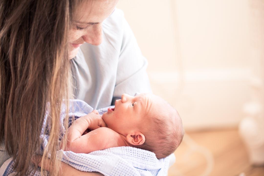 An image of Jasper and his mum - newborn photography by Sam of Hansford Carter, a Kent wedding photographer