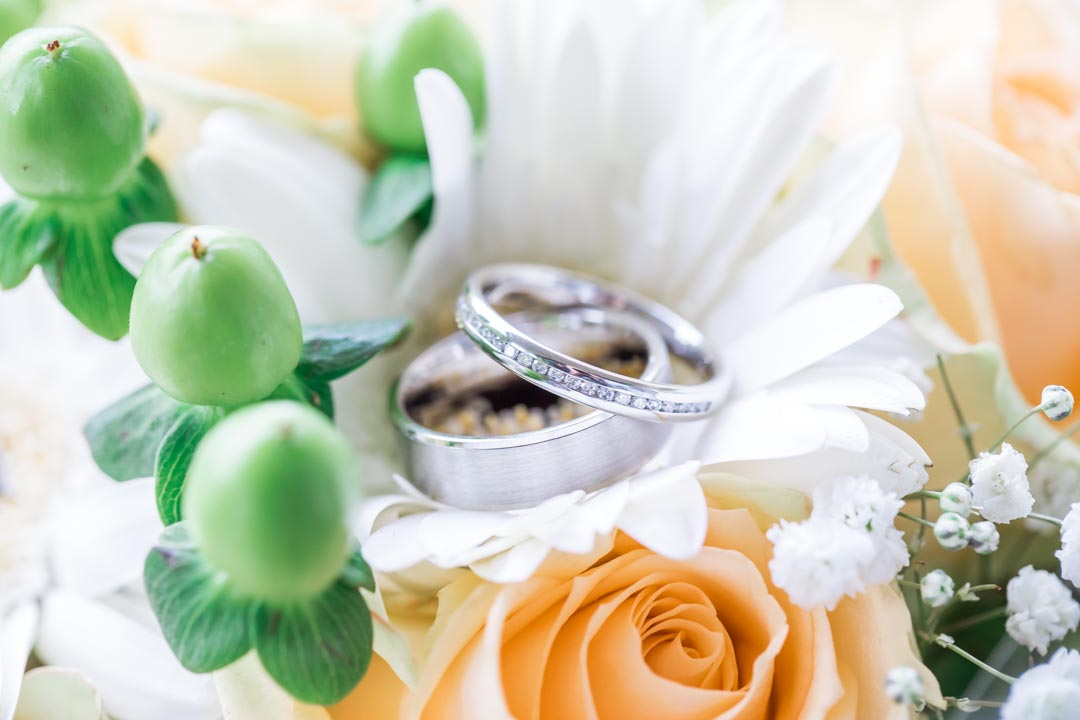 An image of the couple's wedding rings - wedding photography by Sam of Hansford Carter, a Kent wedding photographer