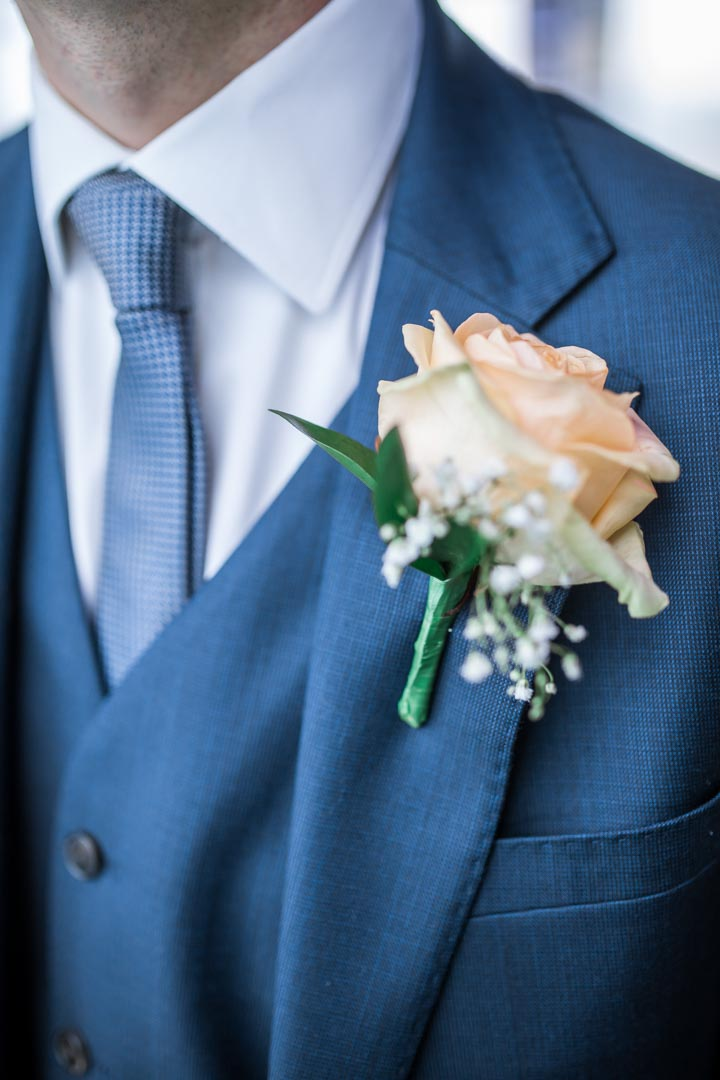 An image of the groom's buttonhole - wedding photography by Sam of Hansford Carter, a Kent wedding photographer
