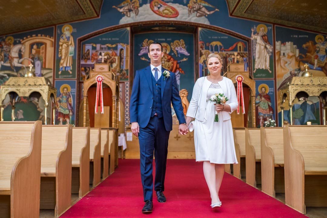 An image of the bride and groom walking down the aisle - wedding photography by Sam of Hansford Carter, a Kent wedding photographer