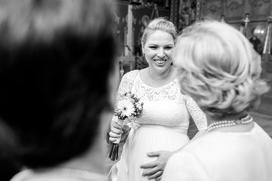 An image of the bride talking to her mother-in-law - wedding photography by Sam of Hansford Carter, a Kent wedding photographer