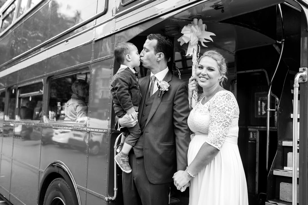 An image of the happy family - wedding photography by Sam of Hansford Carter, a Kent wedding photographer