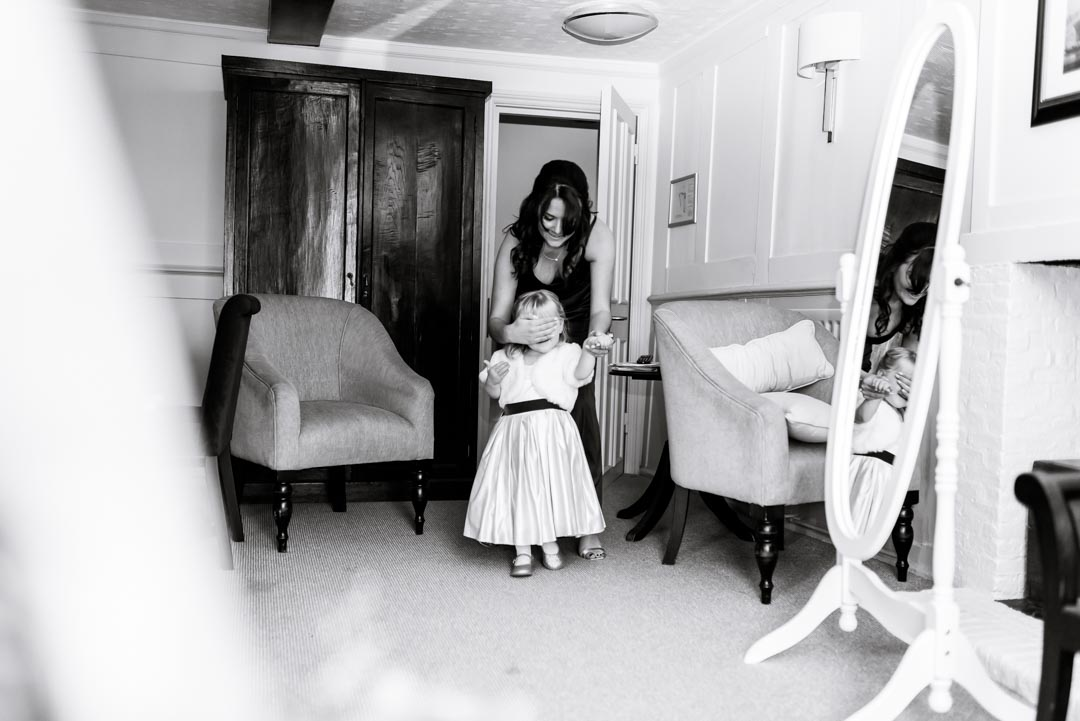 An image of the bride's daughter seeing her dress - wedding photography by Sam of Hansford Carter, a Kent-based wedding photographer