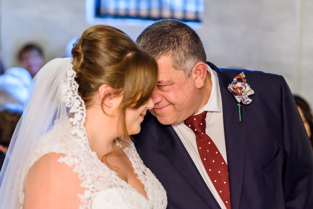An image of the bride's father giving her away - wedding photography by Sam of Hansford Carter, a Kent-based wedding photographer