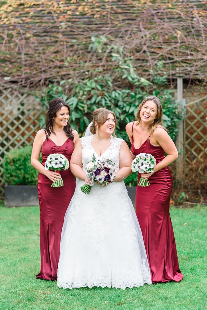 An image of the bride and her bridesmaids - wedding photography by Sam of Hansford Carter, a Kent-based wedding photographer