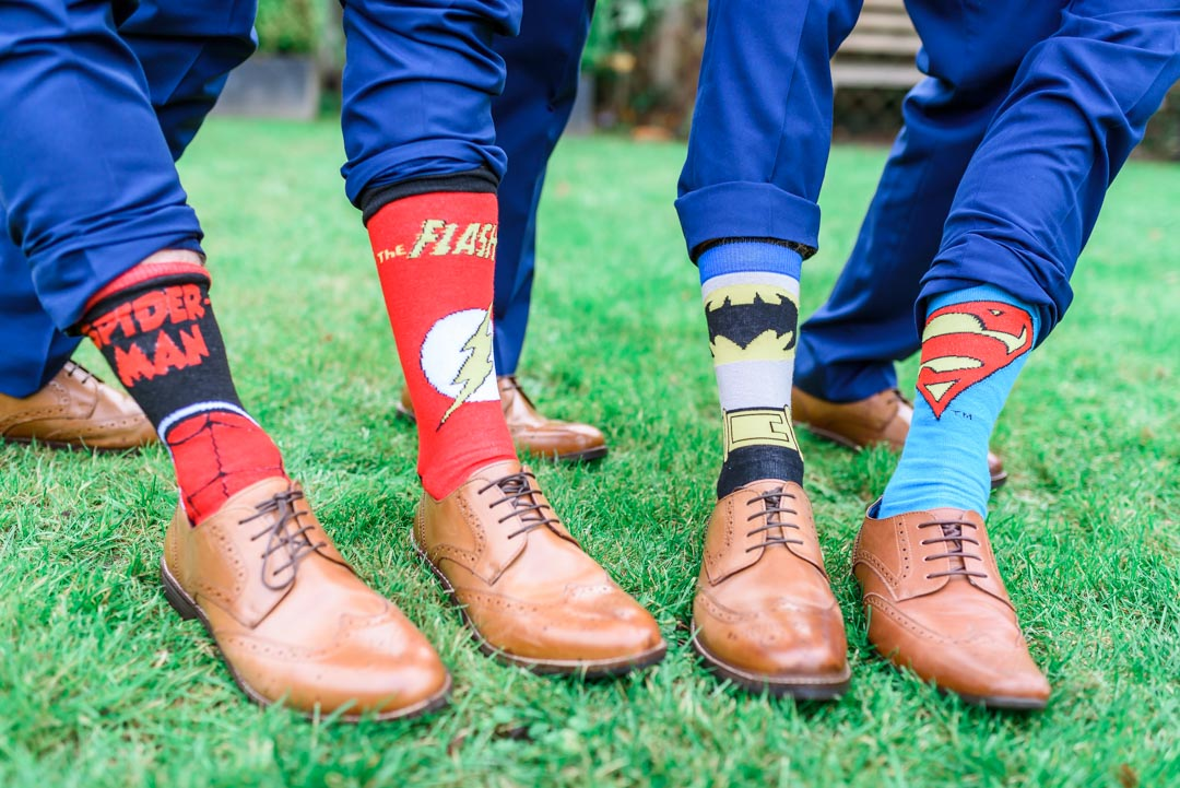 An image of the groomsmen's superhero socks - wedding photography by Sam of Hansford Carter, a Kent-based wedding photographer