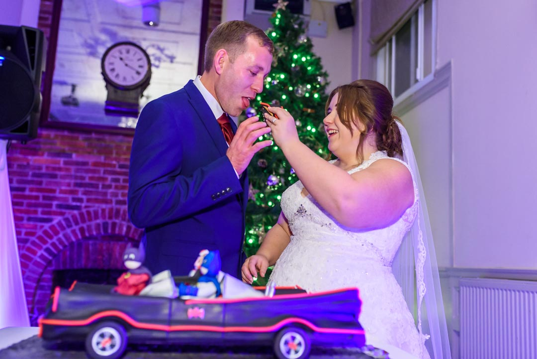 An image of the cake cutting - wedding photography by Sam of Hansford Carter, a Kent-based wedding photographer
