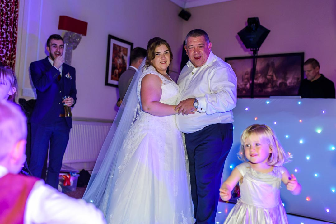 An image of the bride dancing with her father - wedding photography by Sam of Hansford Carter, a Kent-based wedding photographer