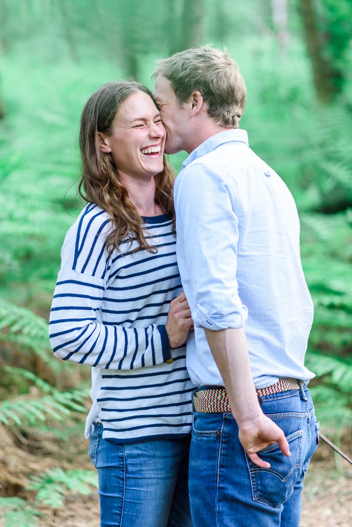 An image of a couple laughing together - couple shoot by Sam of Hansford Carter, a Kent-based wedding photographer