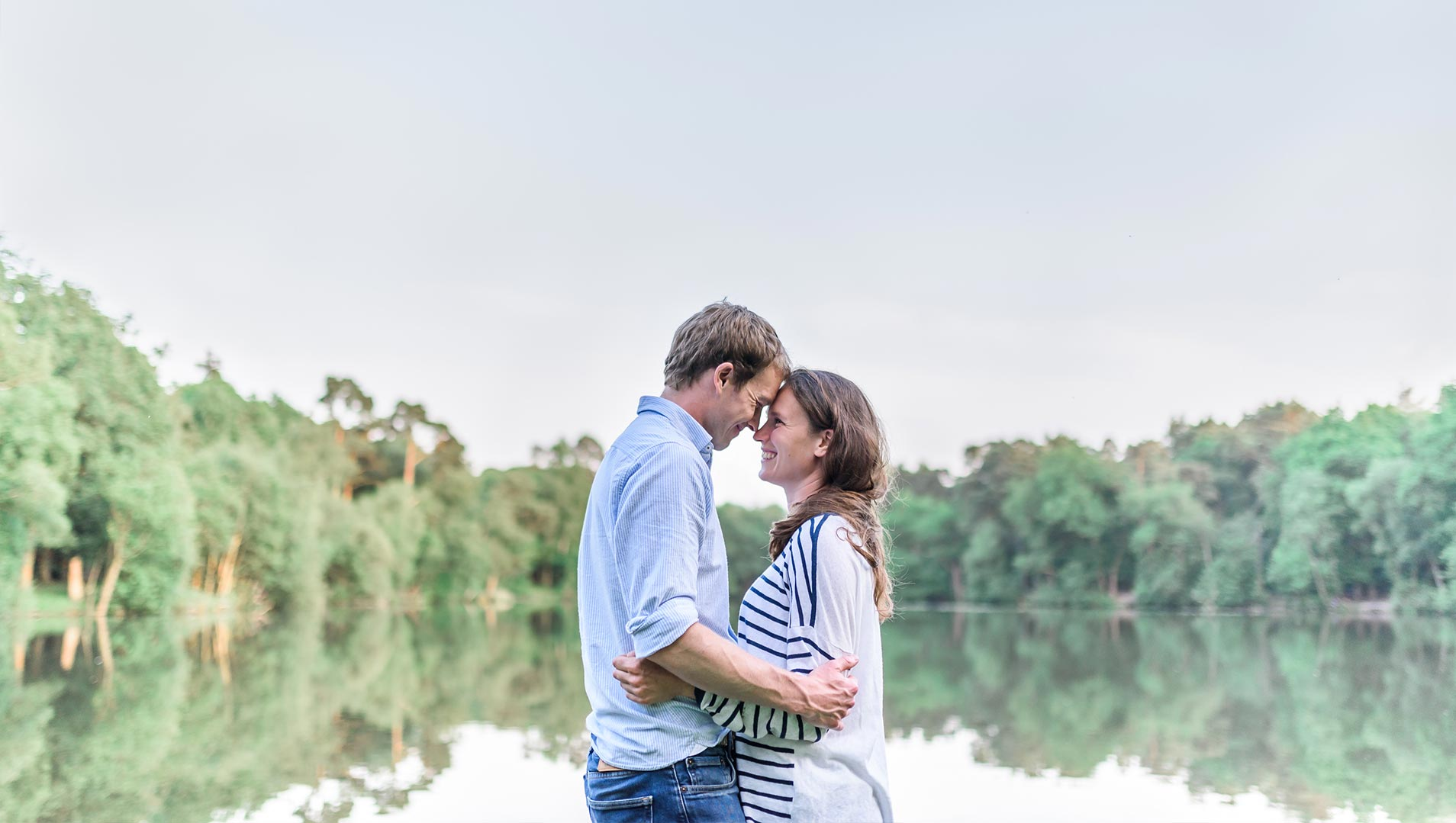 An image of a couple by a lake - couple shoot by Sam of Hansford Carter, a Kent-based wedding photographer