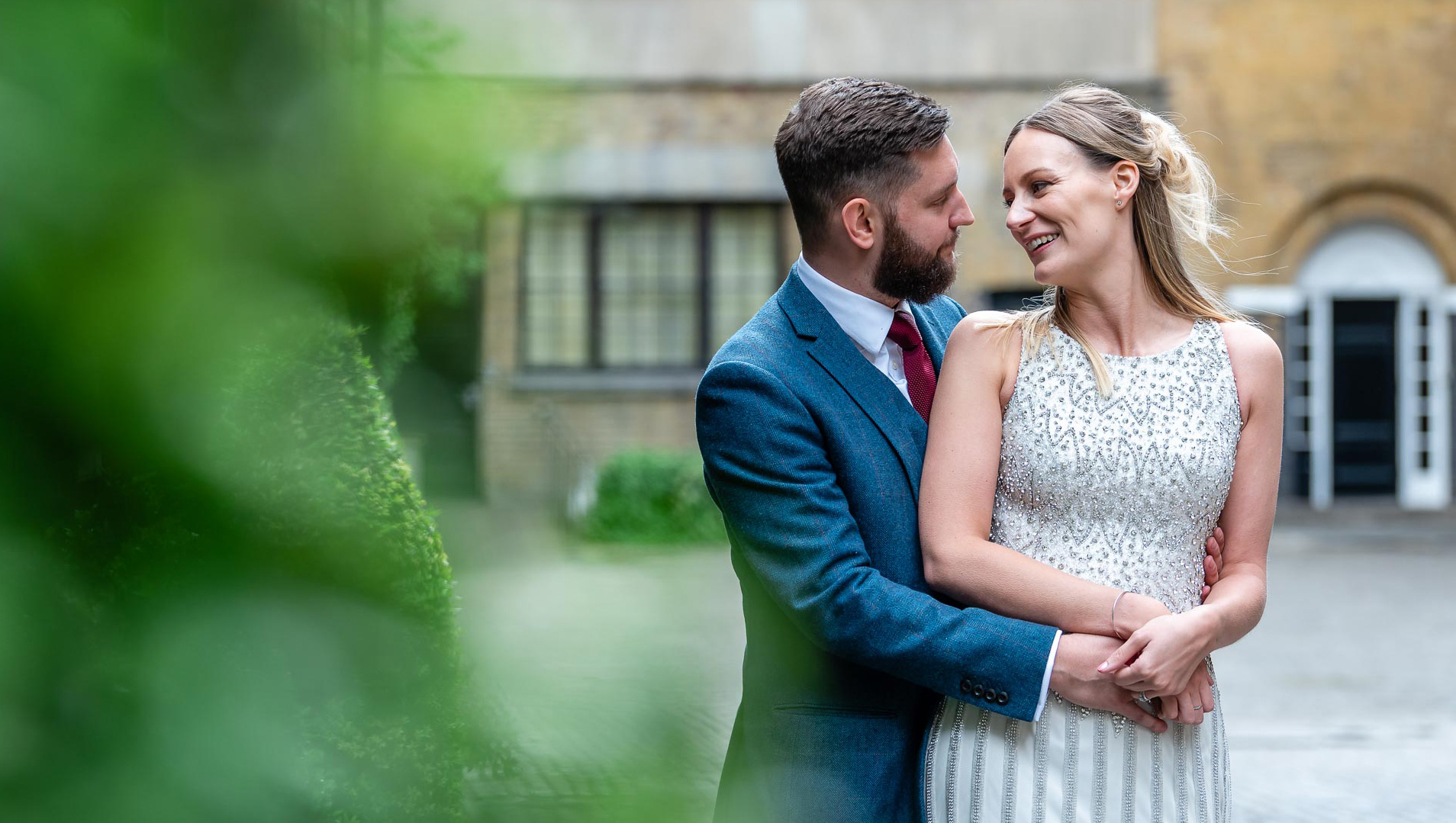 An image of a happy couple together on their wedding day - wedding day photography by Sam of Hansford Carter, a Kent-based wedding photographer
