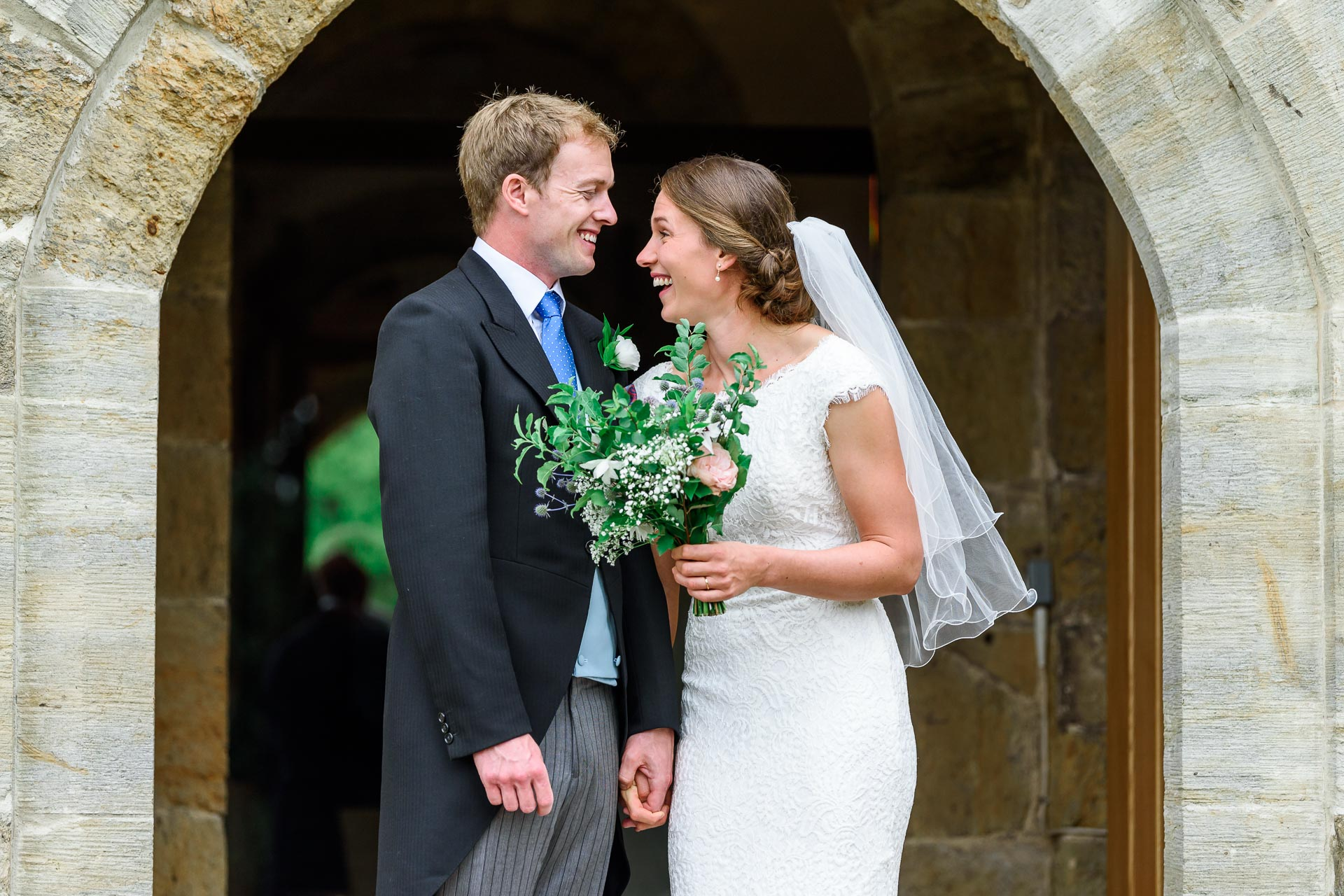 An image of a just married couple on their wedding day - wedding day photography by Sam of Hansford Carter, a Kent-based wedding photographer