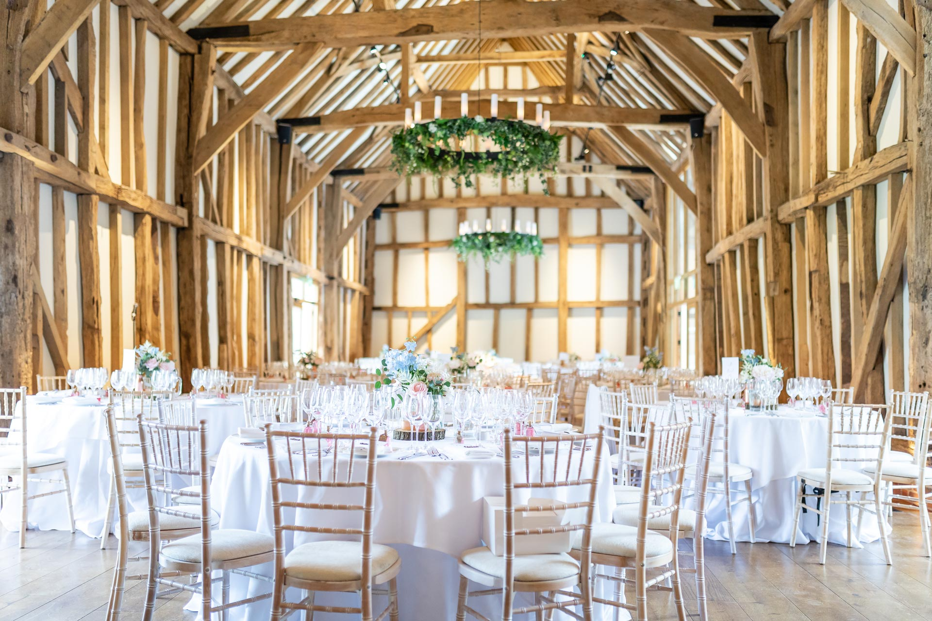 An image of a barn reception venue - wedding day photography by Sam of Hansford Carter, a Kent-based wedding photographer