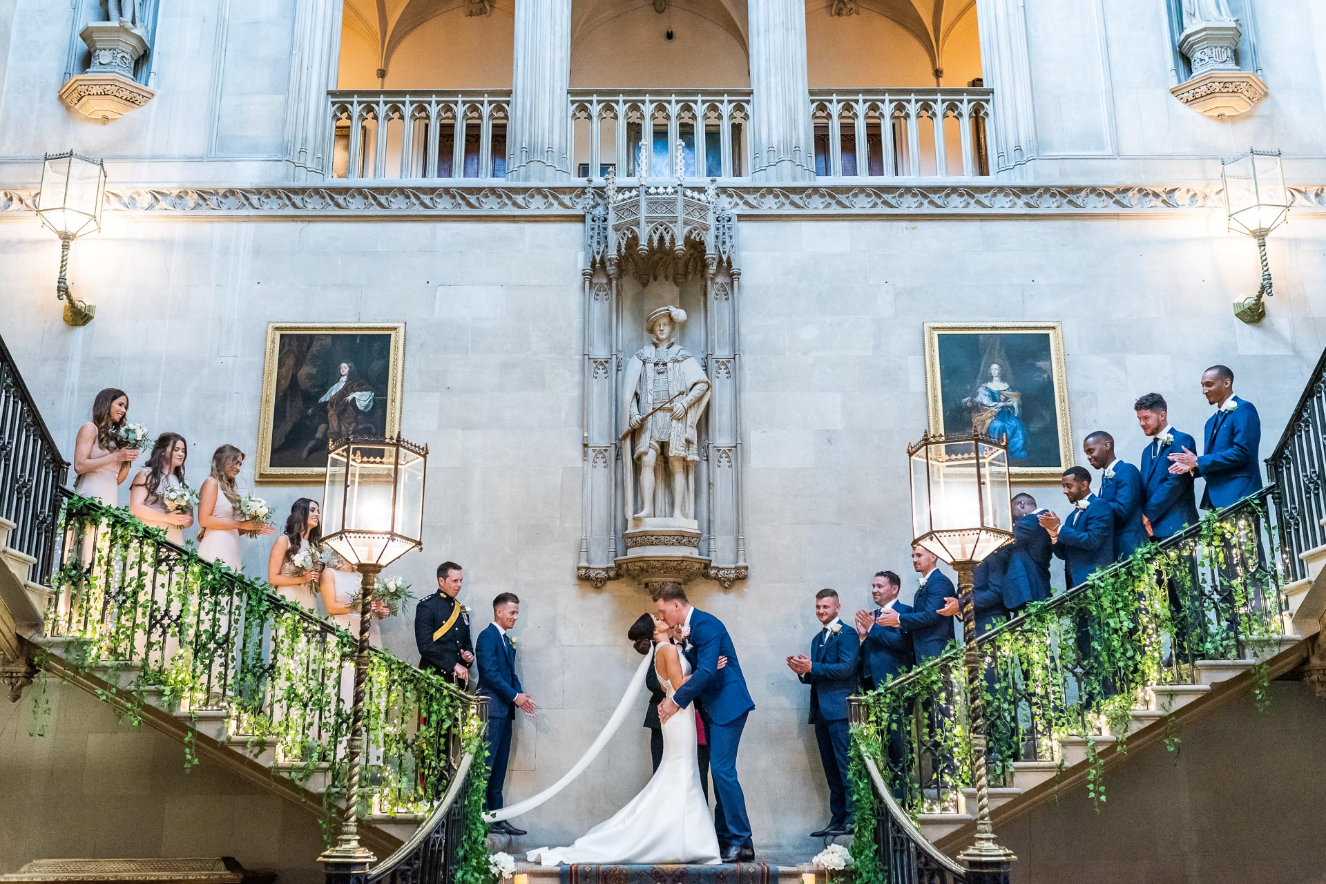 An image of a bride and groom's first kiss - wedding day photography by Sam of Hansford Carter, a Kent-based wedding photographer